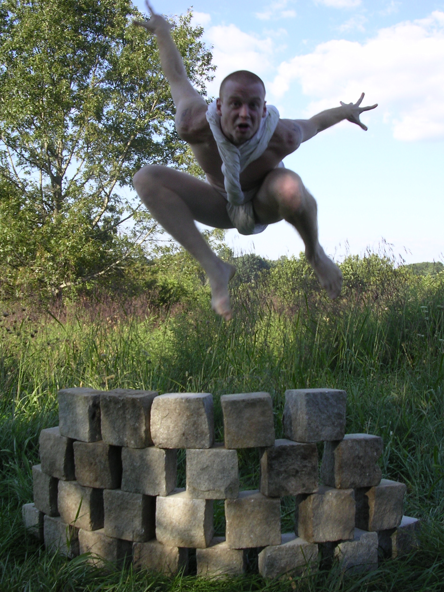 "David Jumping Over Wall, ""Cairn"" photo by JBG"